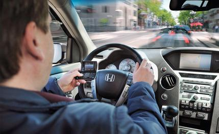 texting-while-driving-how-dangerous-is-it-photo-283840-s-429x262