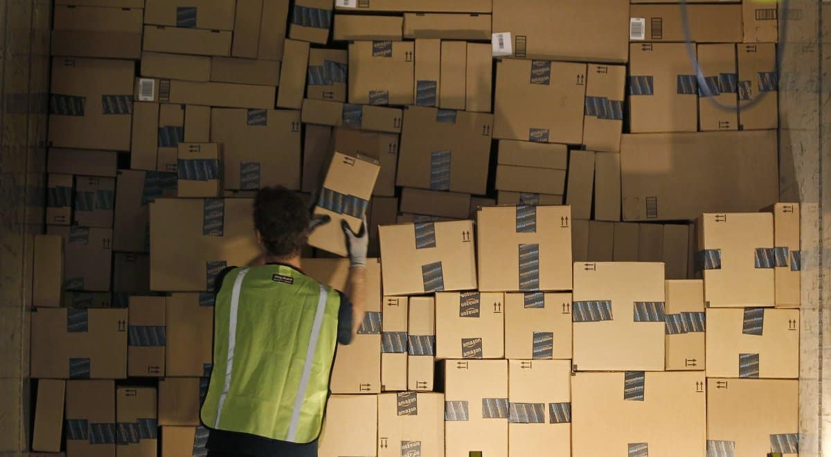 working-in-an-amazon-warehouse-is-as-youd-expect-very-physical-work-employees-need-to-be-able-to-lift-up-to-49-pounds-and-stand-or-walk-for-10-12-hours-per-day