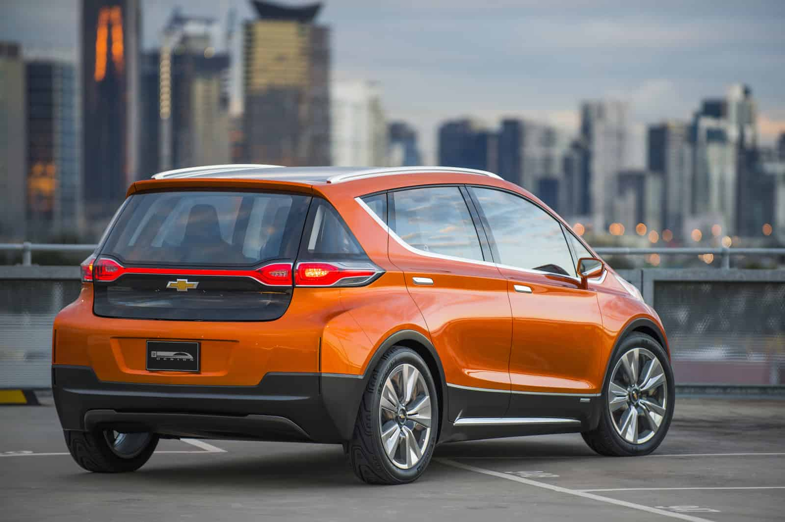 2015 Chevrolet Bolt EV Concept all electric vehicle. Rear ¾ in city scape. Bolt EV Concept builds upon Chevy's experience gained from both the Volt and Spark EV to make an affordable, long-range all-electric vehicle to market. The Bolt EV is designed to meet the daily driving needs of Chevrolet customers around the globe with more than 200 miles of range and a price tag around $30,000.