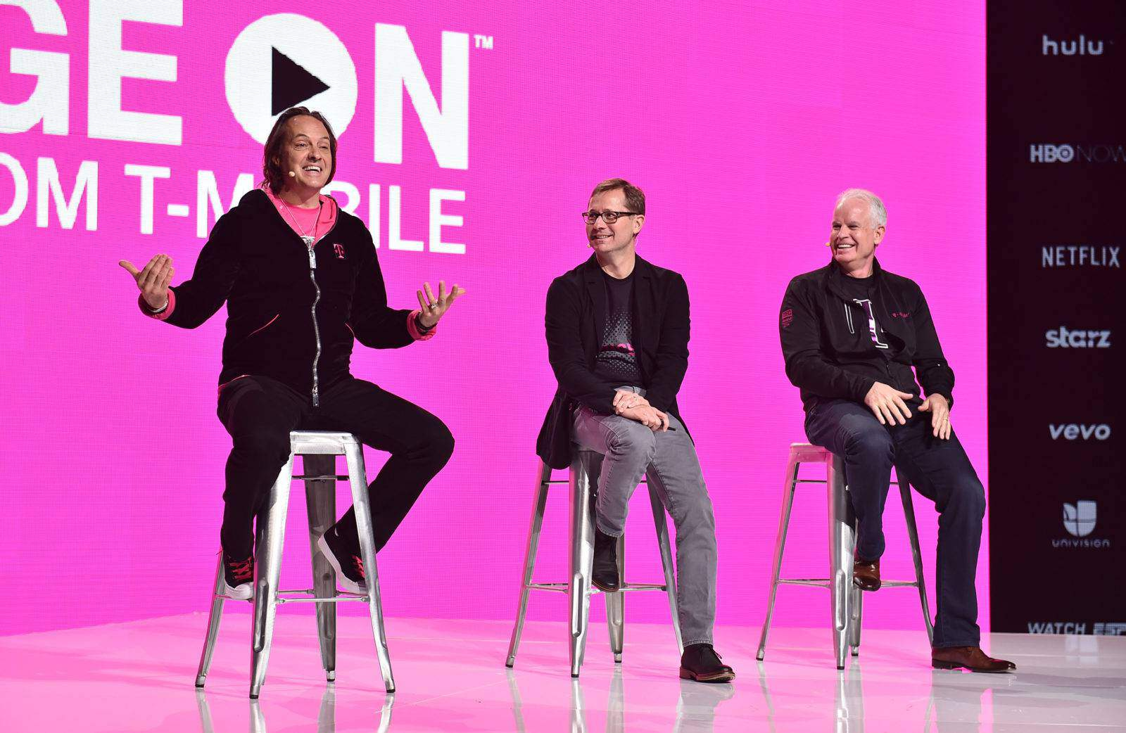 IMAGE DISTRIBUTED FOR T-MOBILE - T-Mobile CEO John Legere, COO Mike Sievert and CTO Neville Ray answer questions during the Un-carrier X at the Shrine Auditorium on Tuesday, Nov. 10, 2015, in Los Angeles. (Photo by Jordan Strauss/AP Images for T-Mobile)
