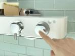 Livin Smart Shower Valve closeup with finger