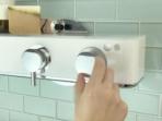 Livin Smart Shower Valve closeup with hand
